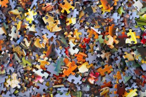 Closeup of a pile of jigsaw puzzle pieces.